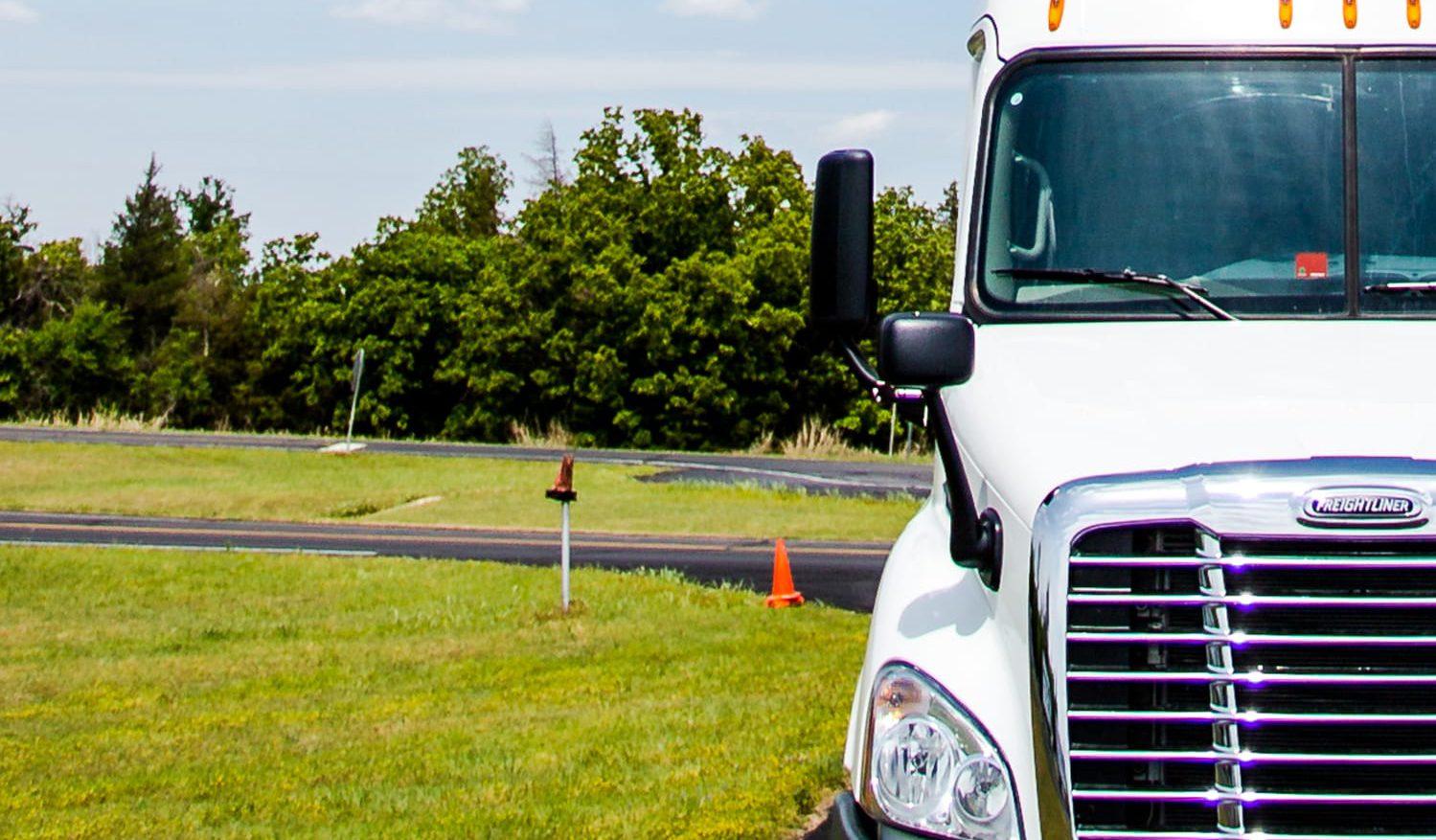 Truck near grass