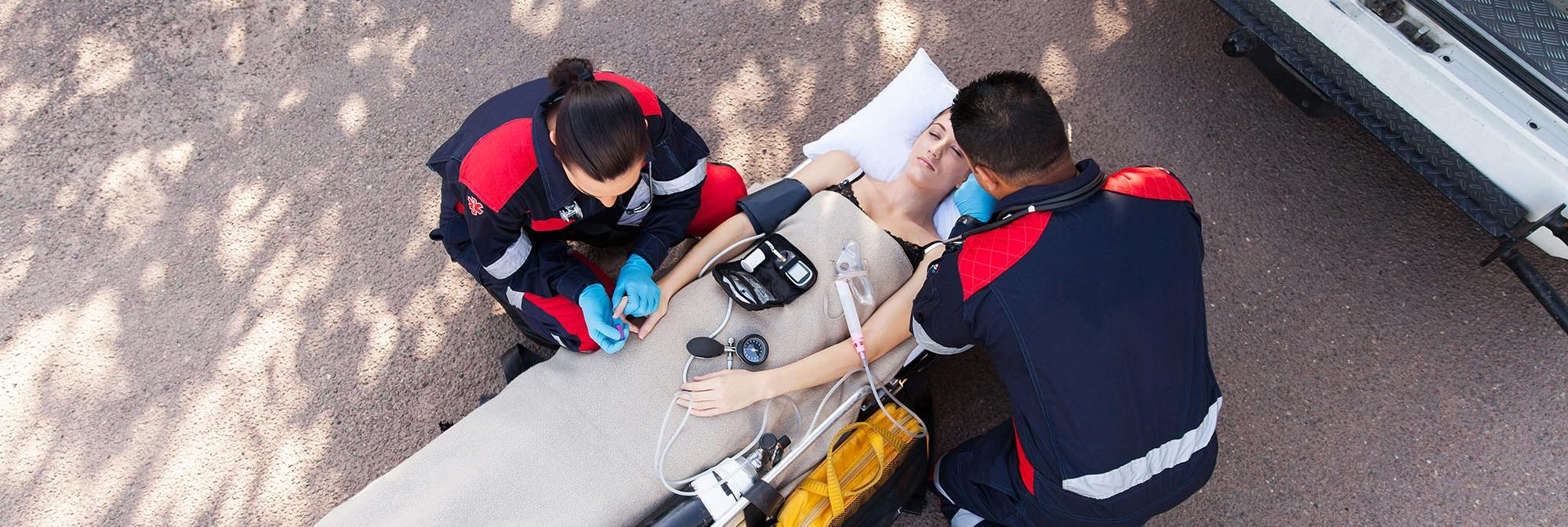 EMTs working on a female patient