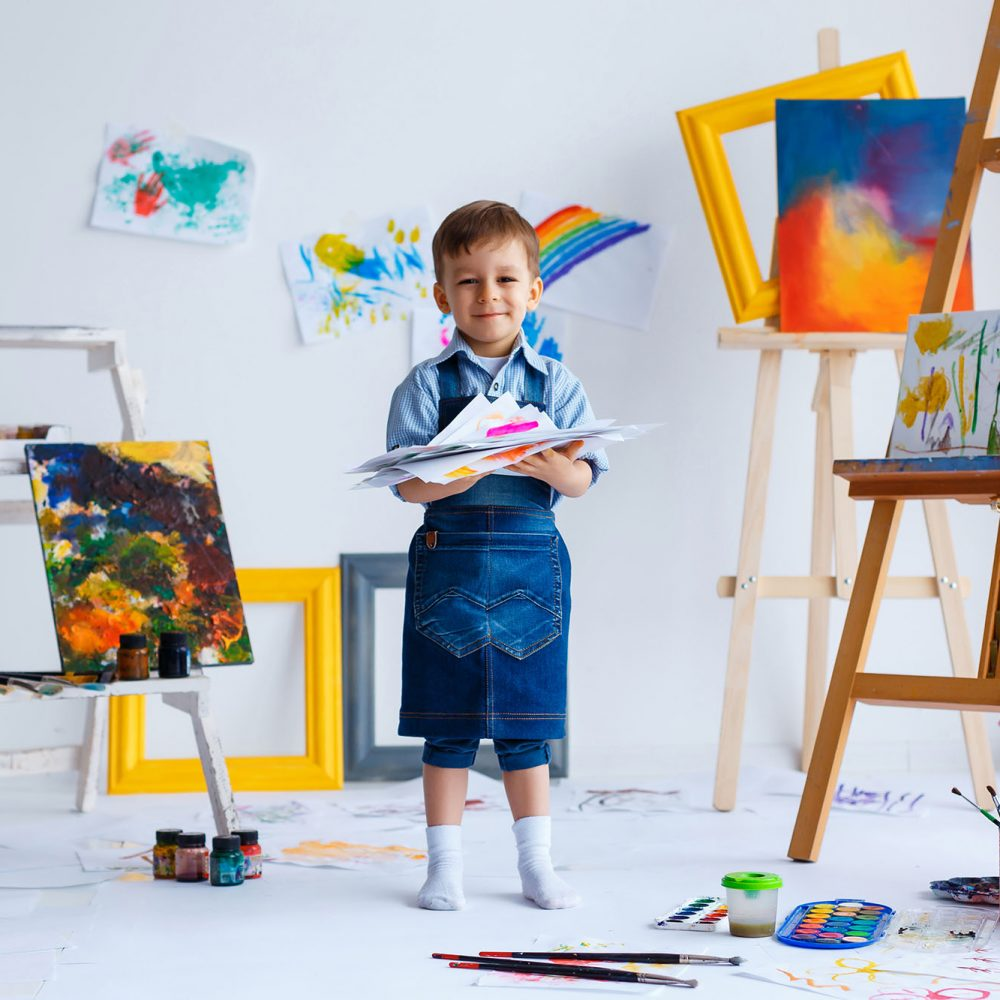 picture of a young child painting at an easel