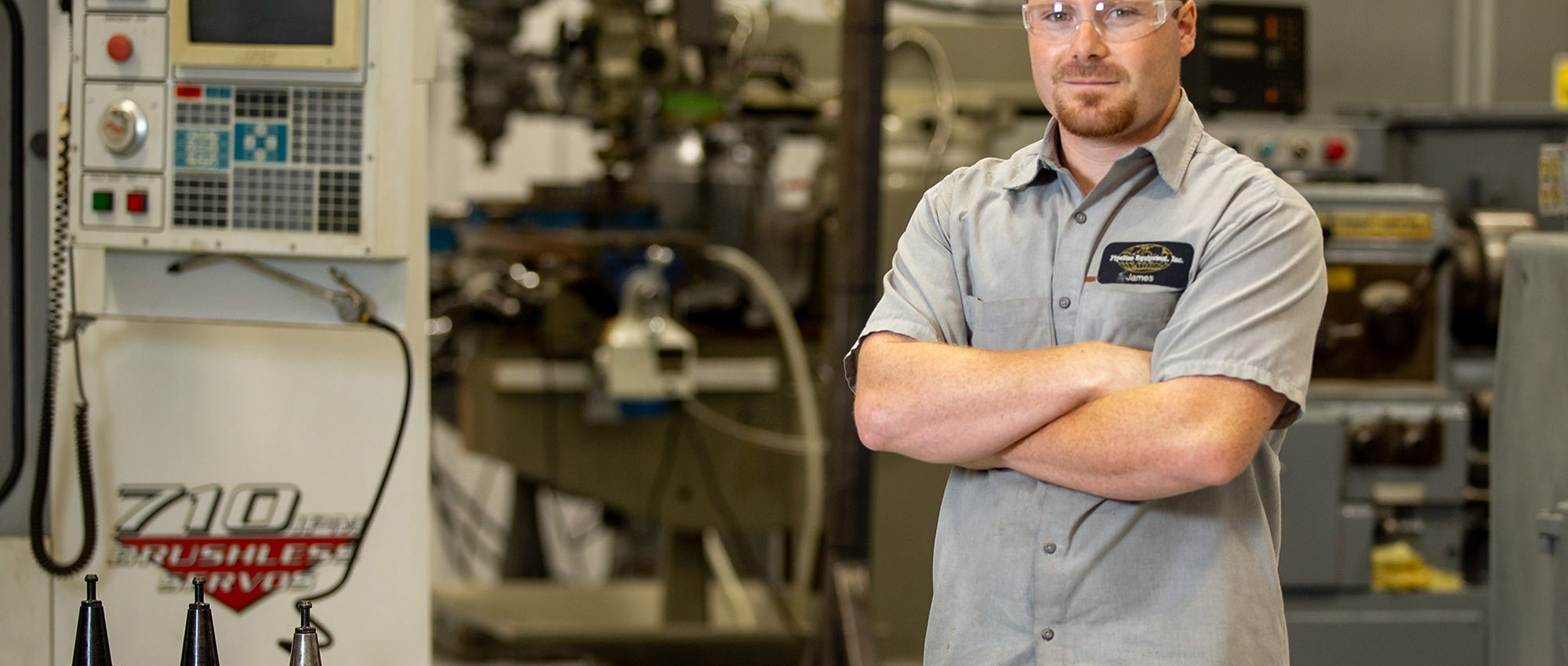 picture of man in safety goggles in a manufacturing position at Central Tech